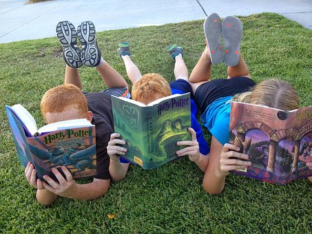 kids reading on grass
