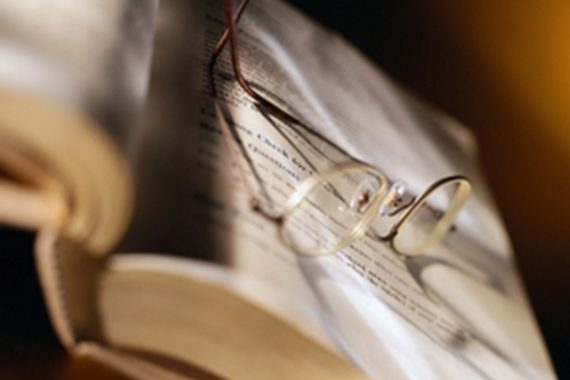 Book with glasses on top